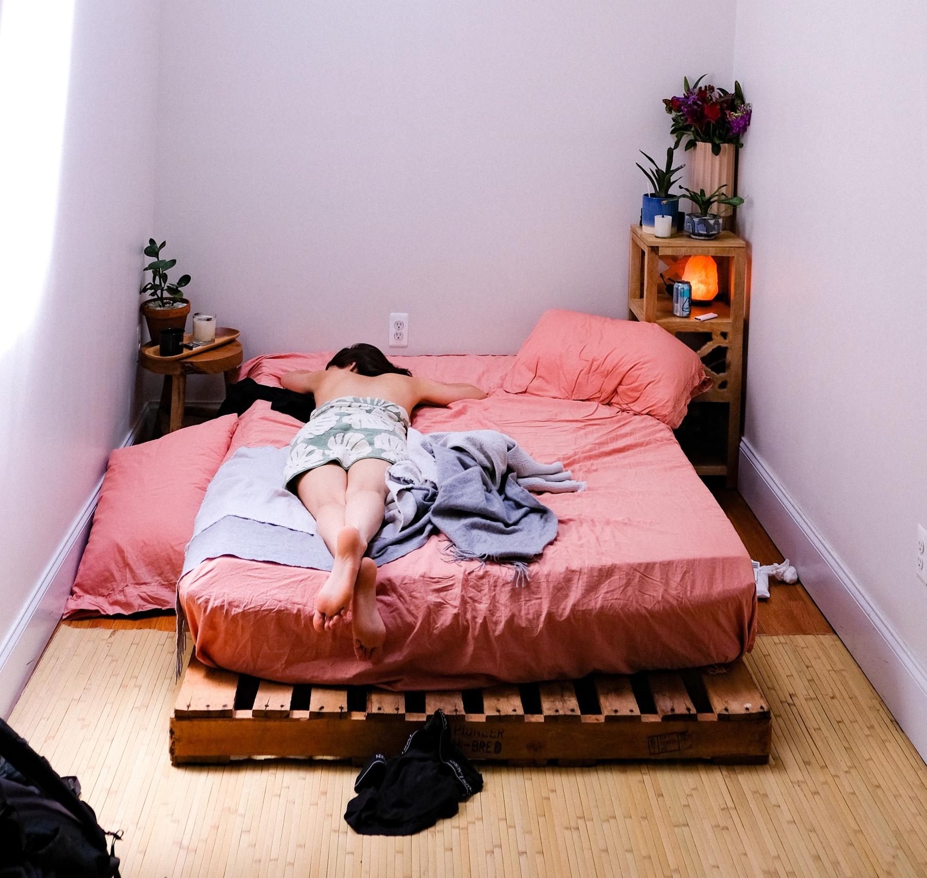 woman on bed - self-actualization through minimalism