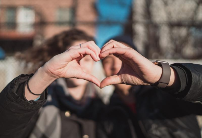 man and woman making heart shape with hands - how to communicate better