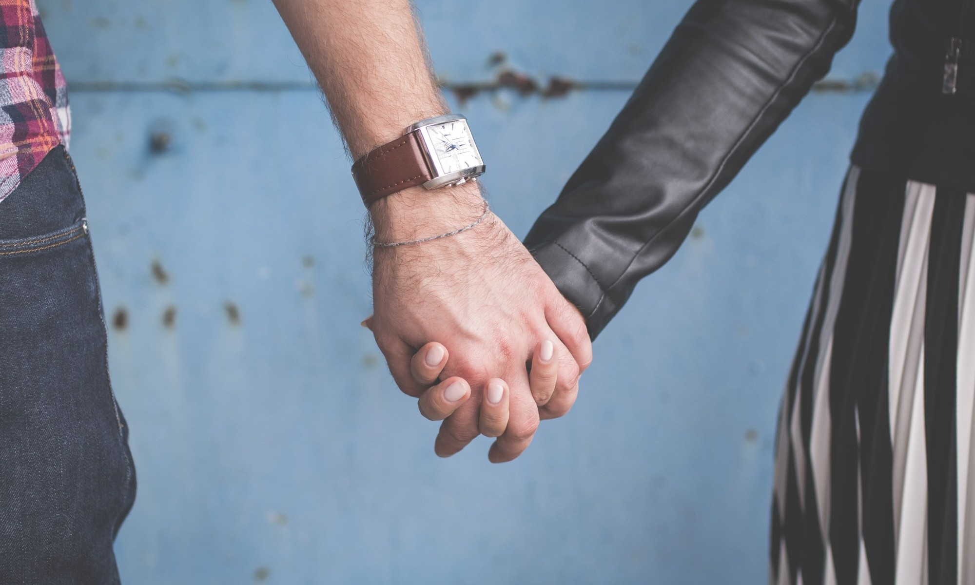 man woman holding hands overcoming codependency