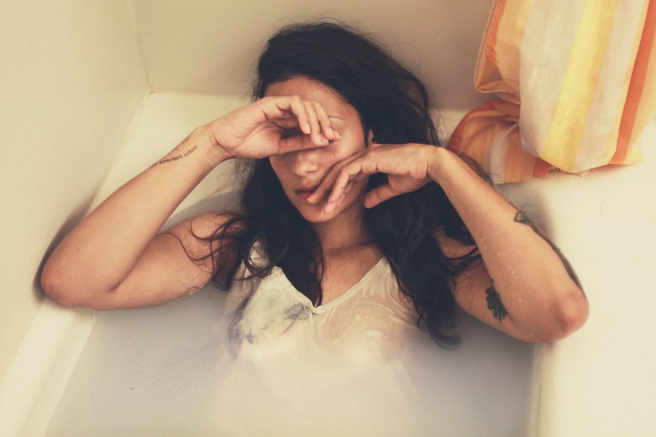 sad woman in bathtub - overcoming relationship dependency